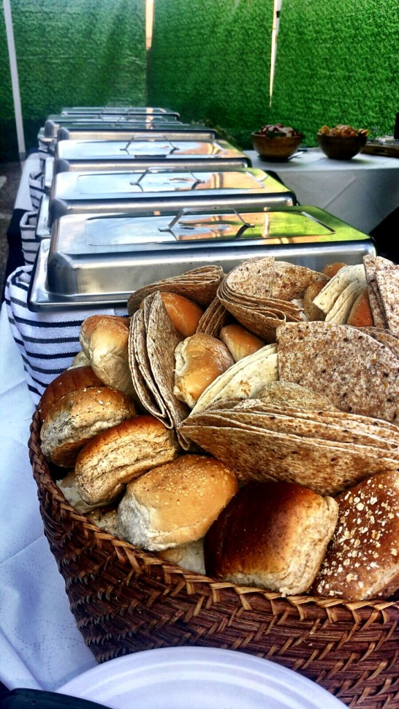 Fresh Bread Rolls With Serving Dishes